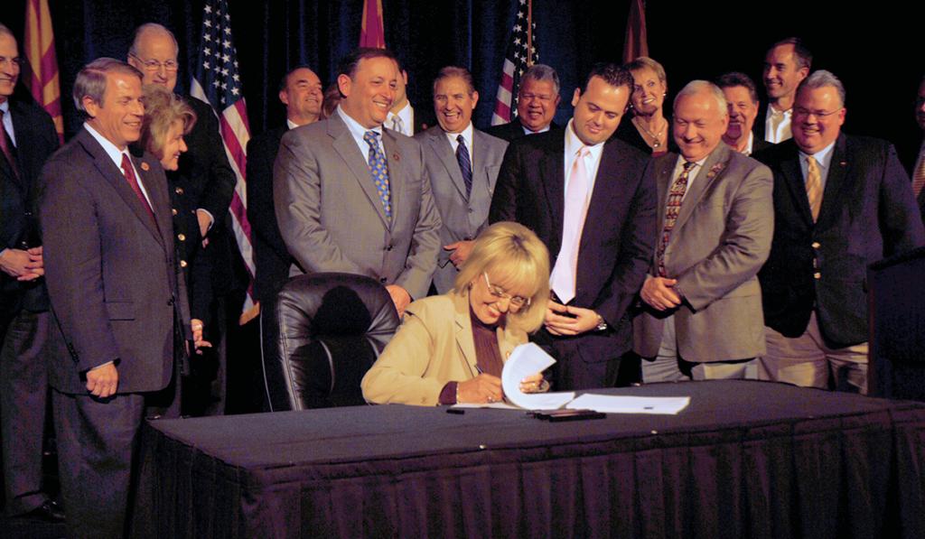 Governor Jan Brewer signs HB 2001 on February 17, 2011, legislation establishing the Arizona Commerce Authority and implementing key economic development initiatives